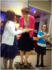 Two of the third-graders receiving The Word