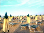 Italians pay for their beach experience by renting a few square feet!