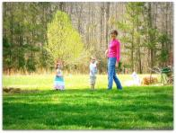 Rebekah with the grands in the spring