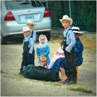 children all dressed alike - waiting for something