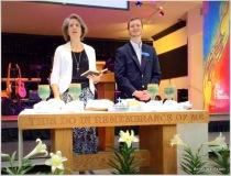Rebekah and John lead communion