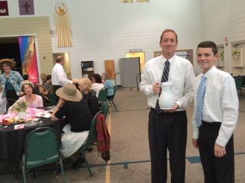 Kevin teaching his son, Ryan, the servant spirit