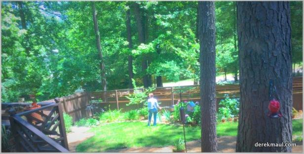Rebekah tending the garden while I'm cooking....