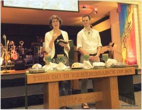 Rebekah and John serving communion