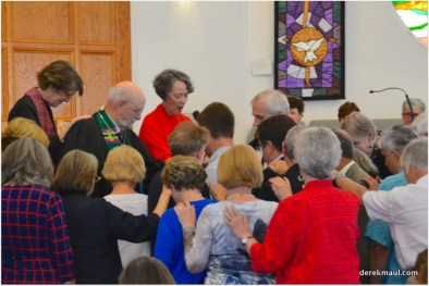 Rev. Moffett Churcn leads prayer of ordination