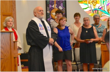 Bob offers the benediction