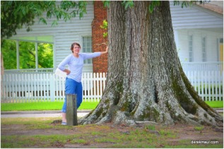 Rebekah holding up the trees