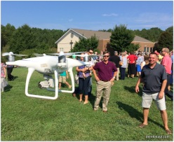 church members entranced by the drone