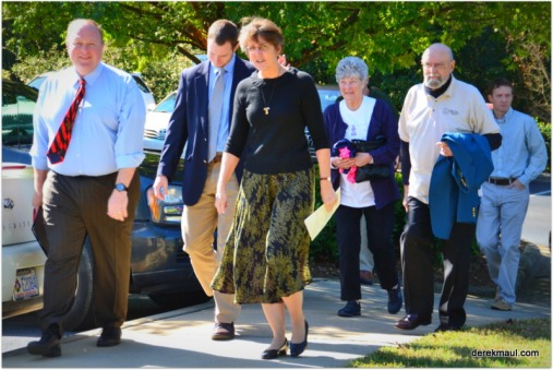 preachers lead processional to plant the tree