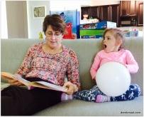 Rebekah reading a story to Beks