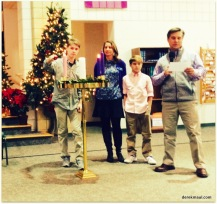The Cutler family light the candle of Hope