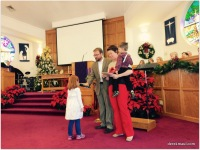 Katherine Pieper and family light the candle at traditional worship