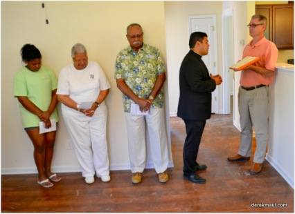 Rev. Marlon Mendieta blesses the home (Rick Beech is the lectern)