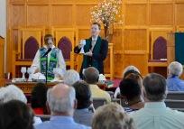John leading communion