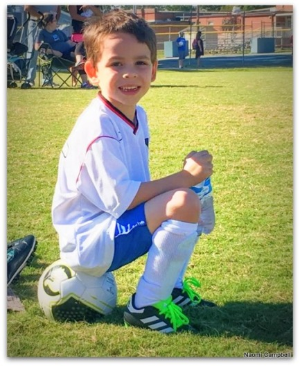 grandson playing soccer