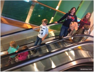 Hannah and kids on the elevator