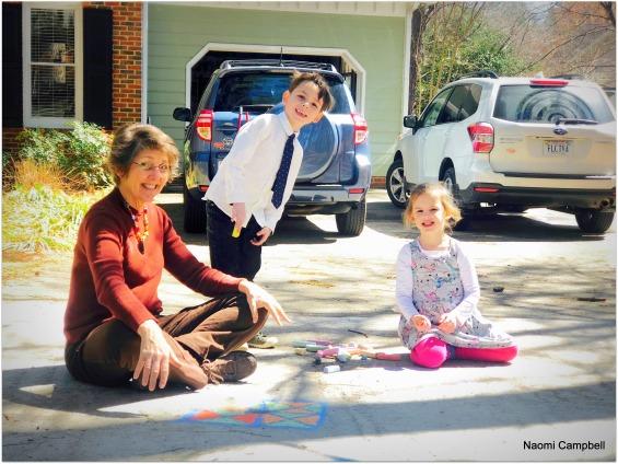 Rebekah doing chalk art with the children