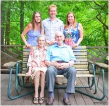 with their three grandchildren