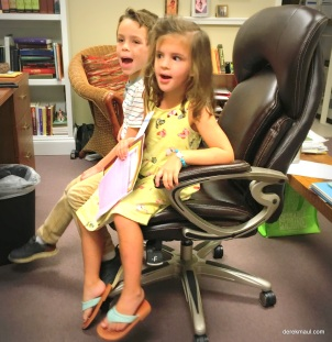 demonstrating the proper way to use a swivel chair