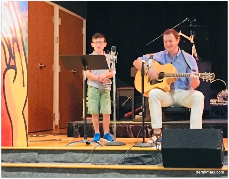 Graham singing with pastor John