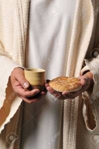 8037891-jesus-holding-a-bread-and-a-wine-as-a-symbol-of-communion