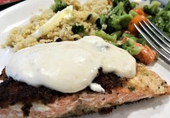 Salmon, with a parmagserved with couscous and mixed veggies