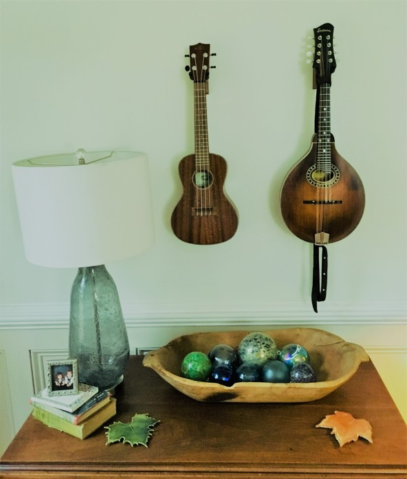 Rebekah's ukulele and my mandolin, where the piano once stood