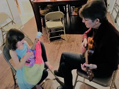 Playing ukulele with Grandmama